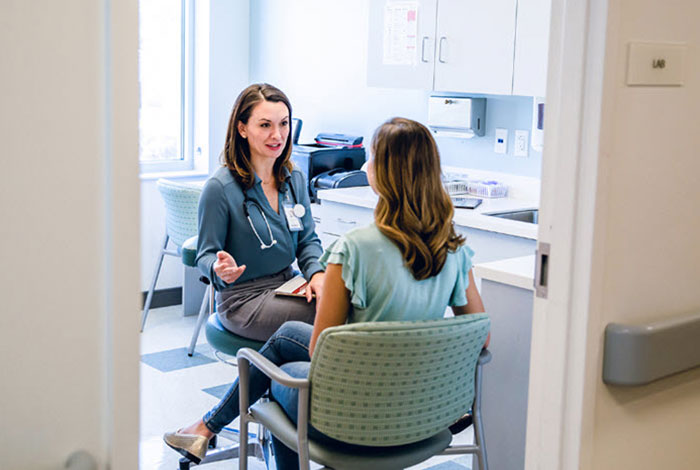 physician talking to a patient in office